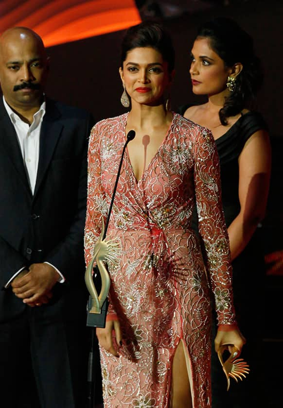 Bollywood actor Deepika Padukone receives the Best Jodi of The Year award during the International Indian Film Academy (IIFA) awards in Macau.