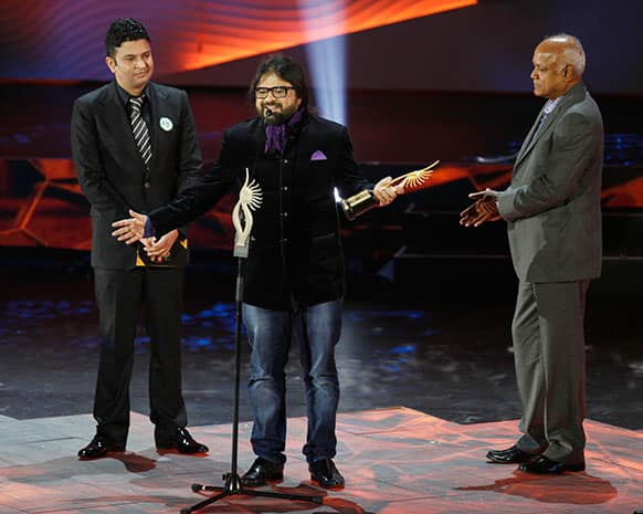 Bollywood's Pritam Chakraborty receives the award for Background Score during the International Indian Film Academy (IIFA) awards in Macau.