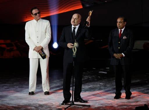 Anupam Kher receives the award for Outstanding Contribution by an Indian to International Cinema during the International Indian Film Academy.