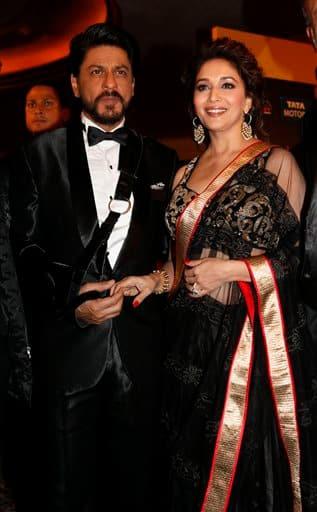 Shah Rukh Khan and Madhuri Dixit arrive for the International Indian Film Academy (IIFA) awards in Macau, Saturday, July 6, 2013.