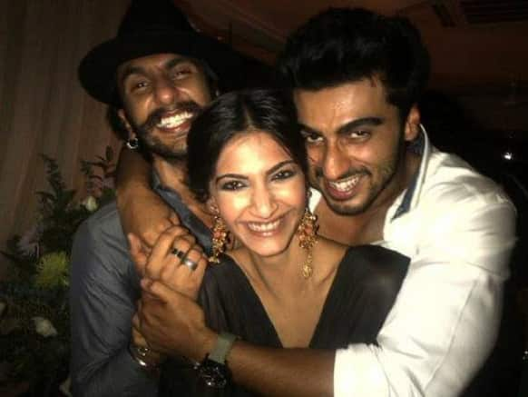 Sonam Kapoor, Arjun Kapoor and Ranveer Singh give a big smile for the camera.