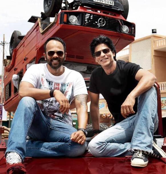 Shah Rukh Khan sat down with director Rohit Shetty to pose for a candid picture on the sets of 'Chennai Express'.