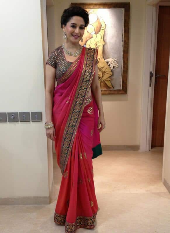Madhuri Dixit poses for the camera, before she heads towards a store launch.                     Pic Courtesy: @MadhuriDixit1