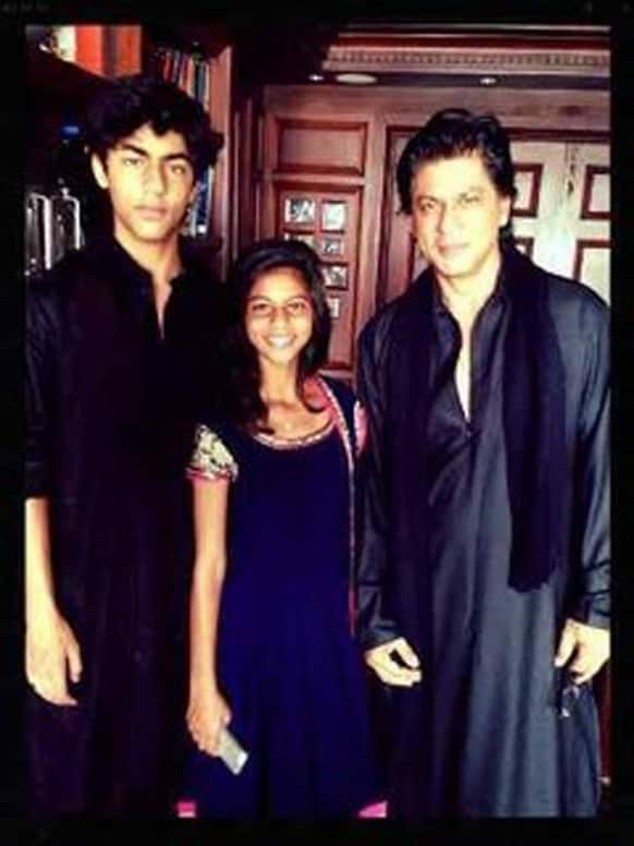 Shah Rukh Khan poses for a picture with his children Aryan and Suhana on Eid.
