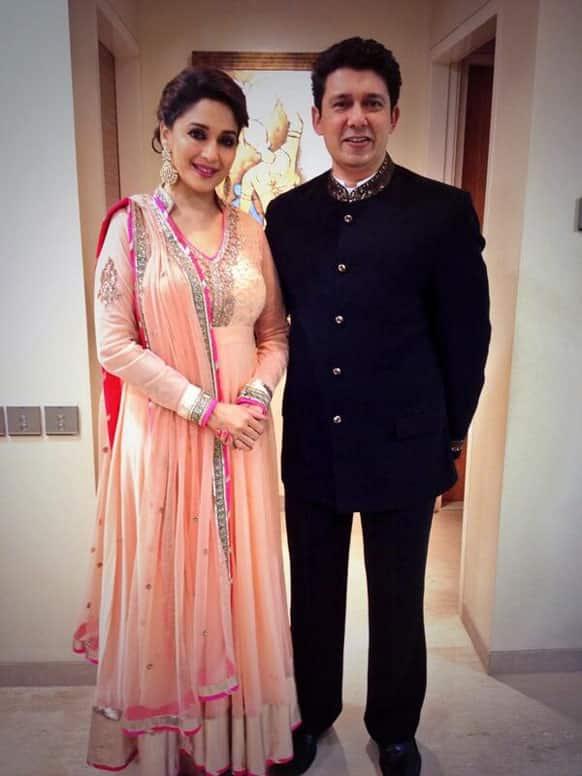 Madhuri Dixit Nene and  Dr Shriram Madhav Nene on their way to Shah Rukh Khan's Eid Part, @MadhuriDixit1