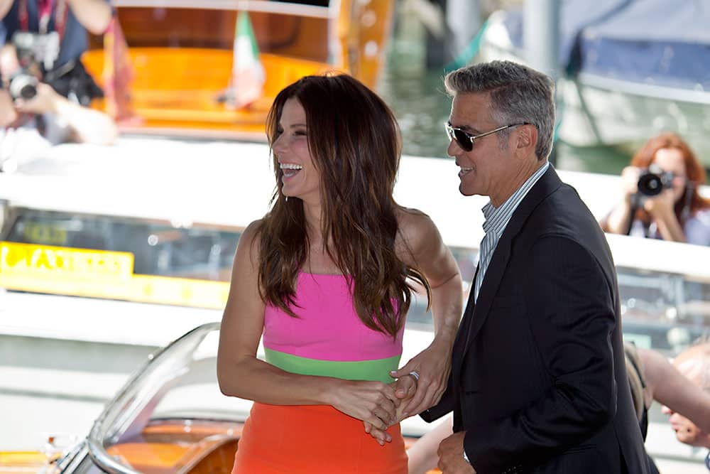 Actors Sandra Bullock and George Clooney arrive to promote their film Gravity at the 70th edition of the Venice Film Festival held from Aug. 28 through Sept. 7, in Venice, Italy.