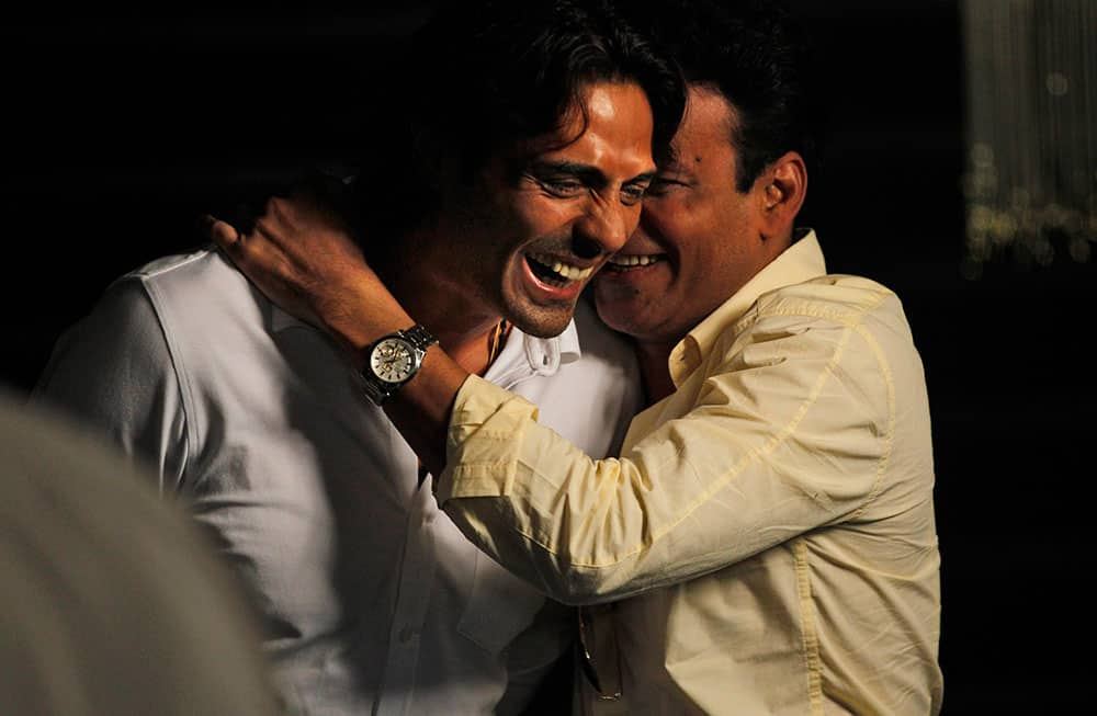 Bollywood actors Arjun Rampal, left, and Manoj Bajpai share a light moment during a promotional event for their upcoming movie