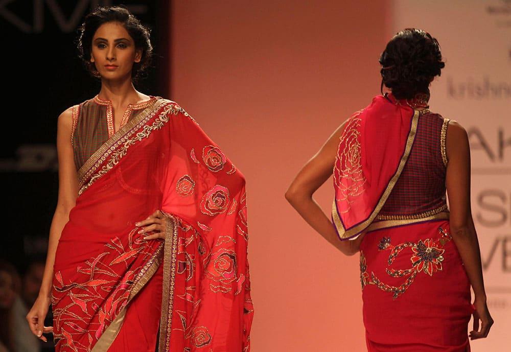 Models display creations by Krishna Mehta at the Lakme Fashion Week in Mumbai.