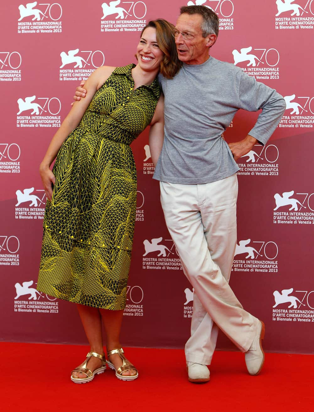 Director Patrice Leconte, right, and actress Rebecca Hall pose for photographers during the photo call for the film A Promise at the 70th edition of the Venice Film Festival.
