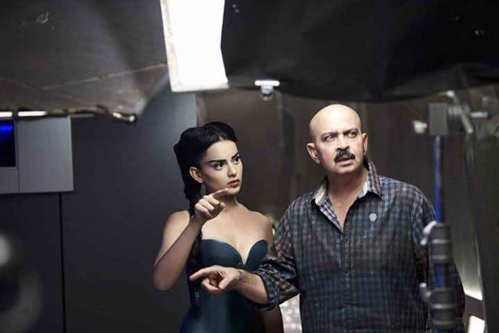 Kangna Ranaut on the sets of 'Krrish 3' with filmmaker Rakesh Roshan.
