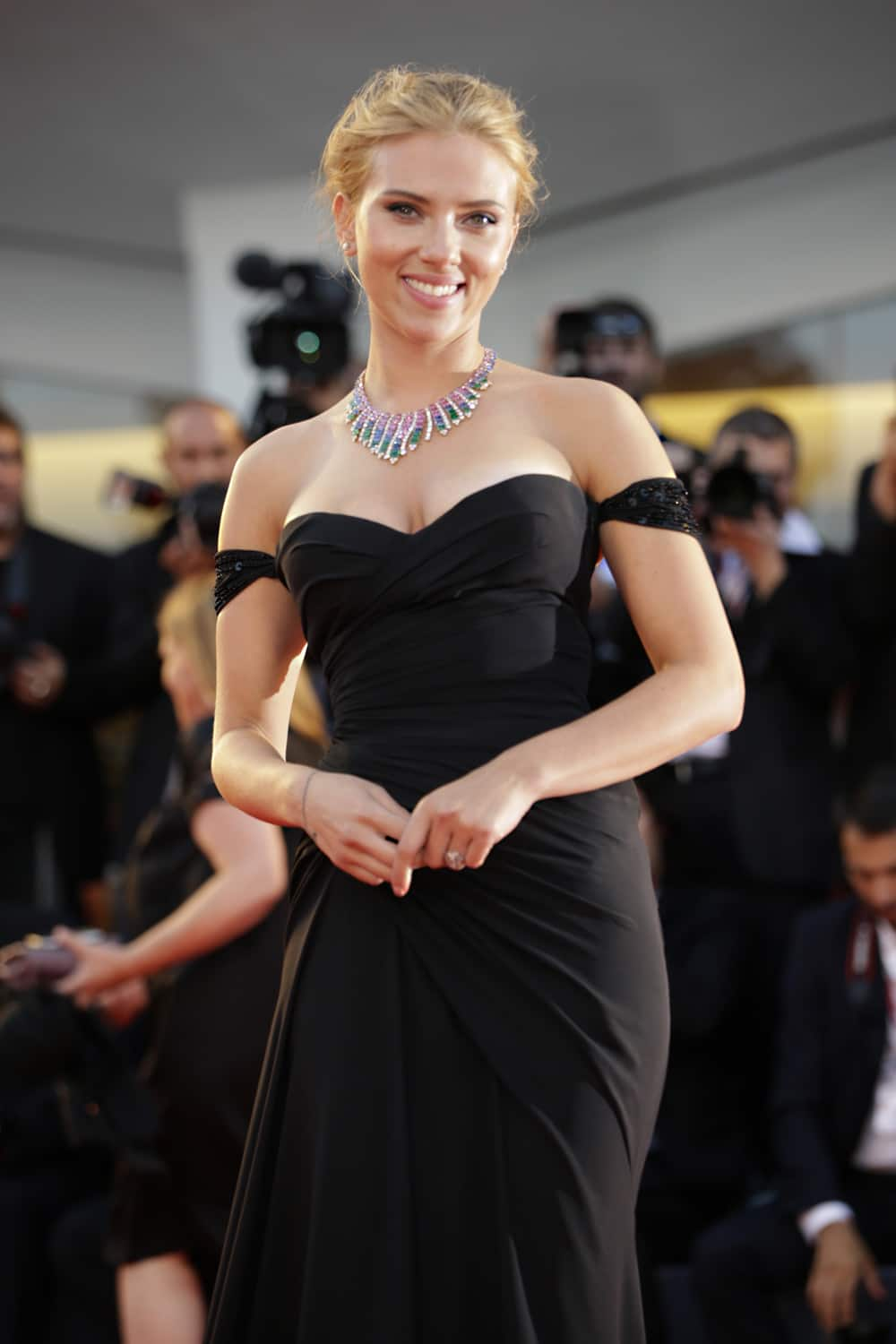 Actress Scarlett Johansson poses for photographers on the red carpet for the screening of the film Under The Skin at the 70th edition of the Venice Film Festival .