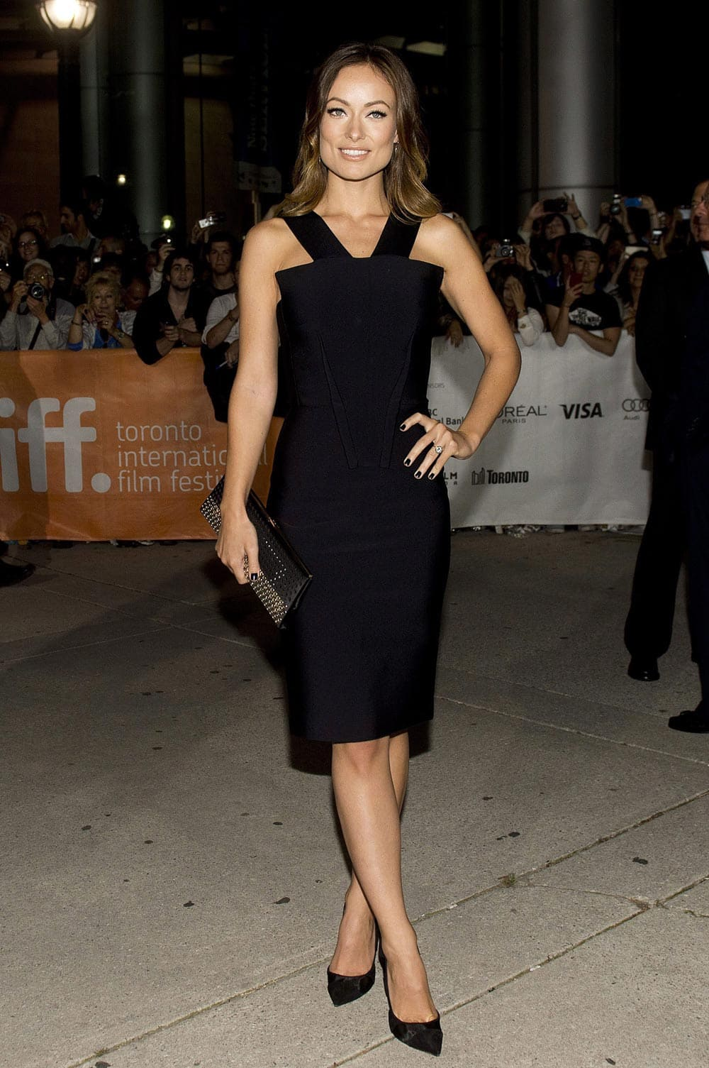 Actress Olivia Wilde poses for a photograph on the red carpet at the gala for the new movie