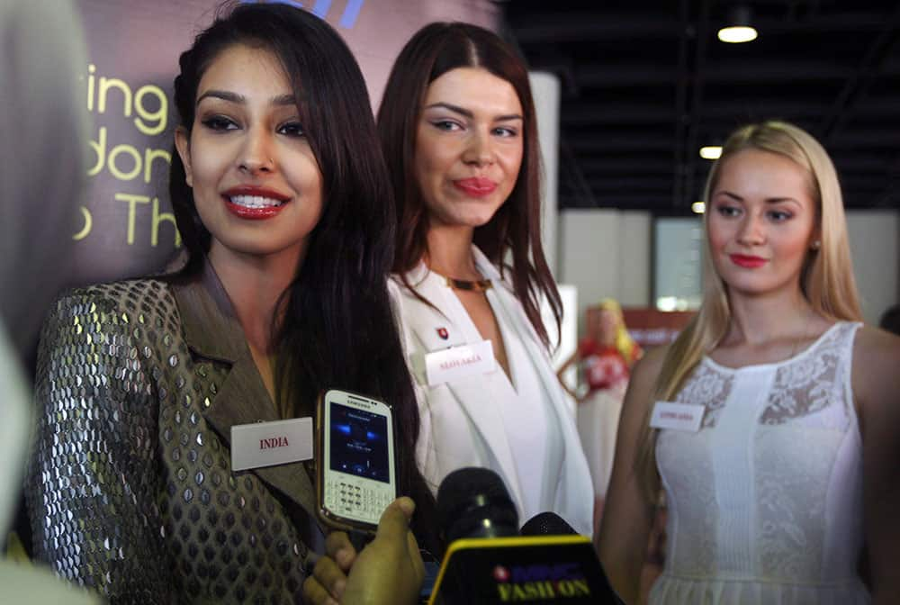 Miss World Pageant contestants, from left, Miss India Navneet Dhillon, Miss Slovakia Karolina Chomistekova and Miss Lithuania Ruta Elizbieta Mazureviciute, talk to reporters in Nusa Dua, Bali, Indonesia.