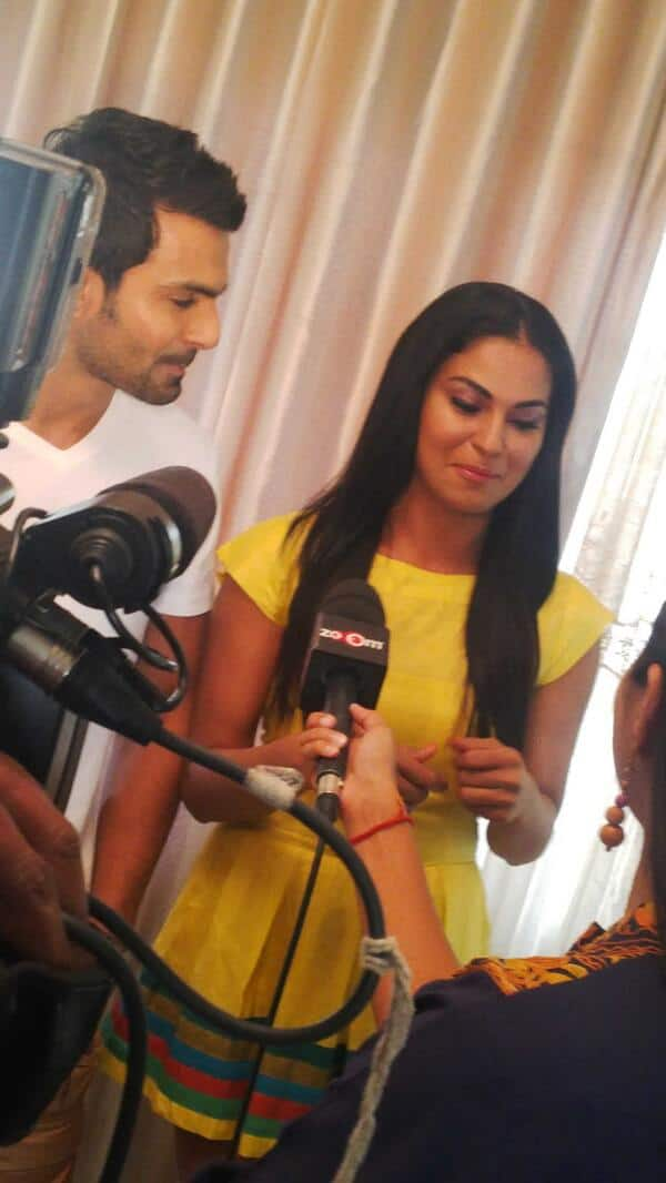 Veena Malik talking to the media persons with her ex-beau Ashmit Patel by her side.