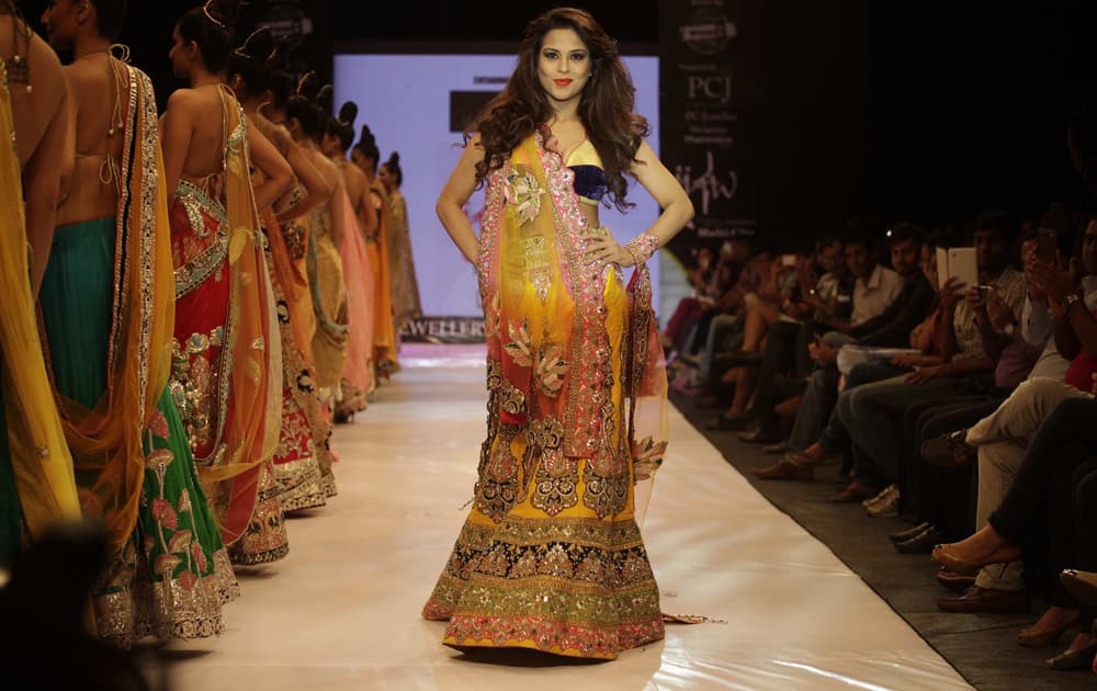 A model displays a creation by designer Mohit Falod during the India Jewellery and Fashion Week in Ahmadabad.