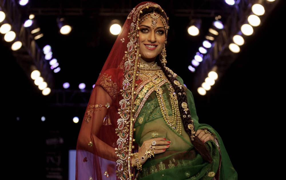 "A model displays a creation by ""Cher Style Check"" during the India Jewellery and Fashion Week (IJFW) in Ahmadabad."