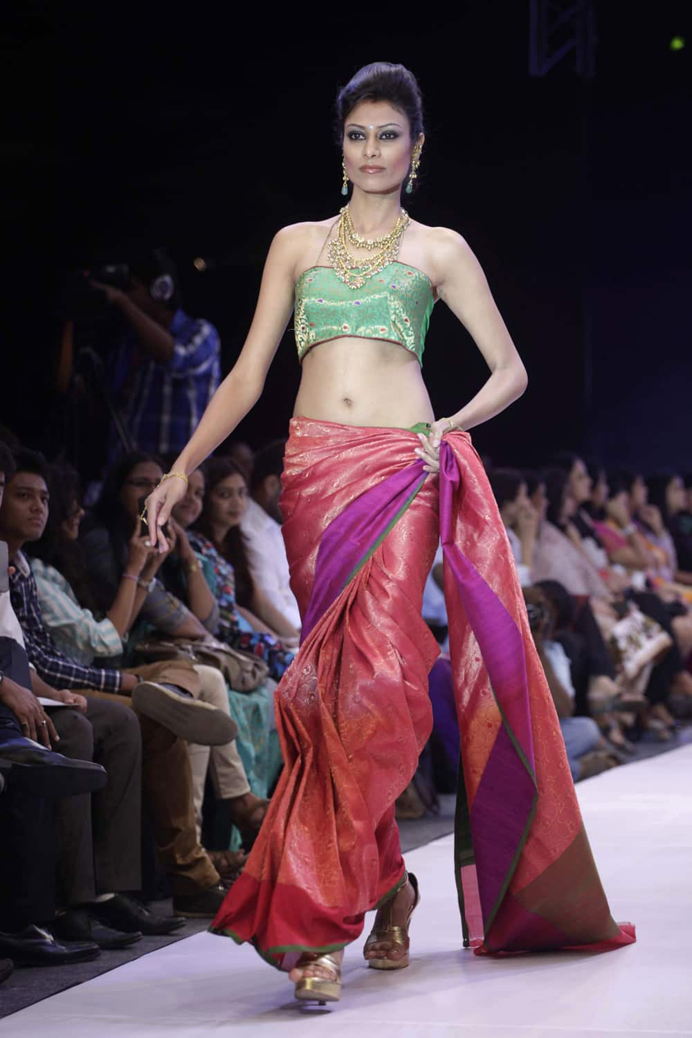 A model displays a creation by Niti Mehta during the India Jewellery and Fashion Week (IJFW) in Ahmadabad.