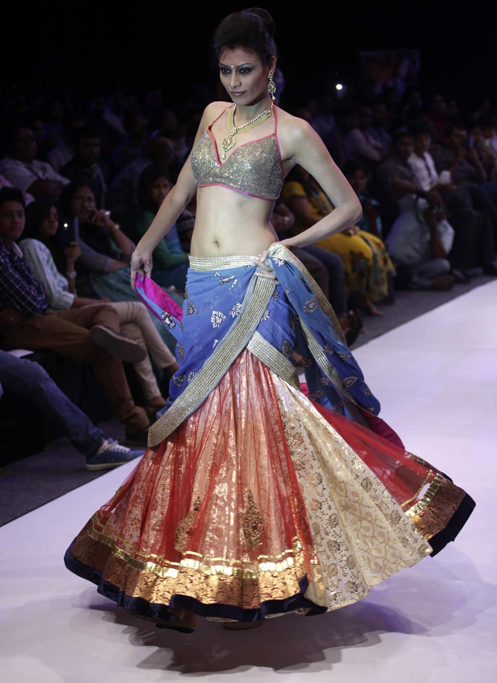 A model displays creations by NS Jewels and Sharad Raghav during the India Jewellery and Fashion Week (IJFW) in Ahmadabad.