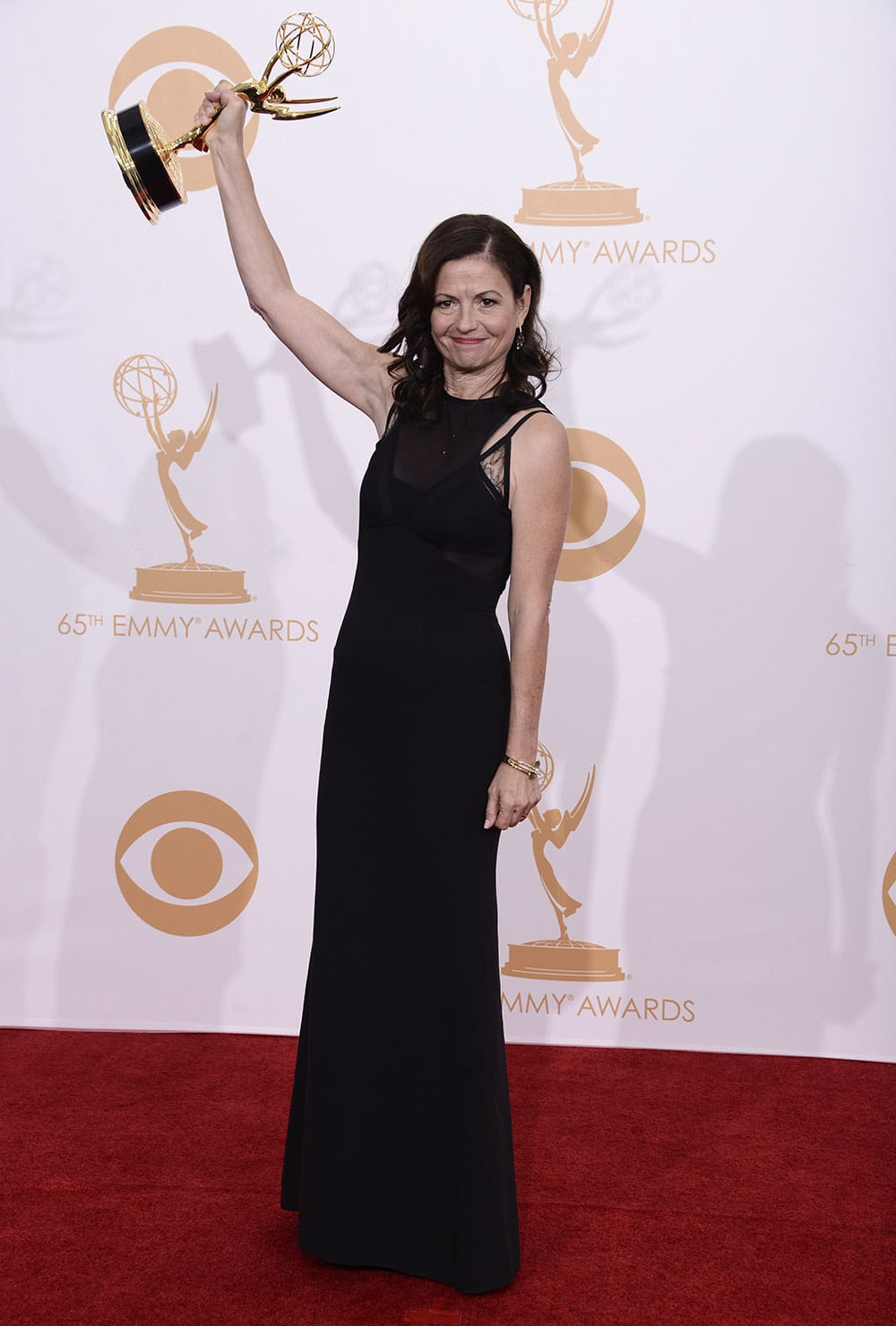Director Gail Mancuso, winner of the best directing for a comedy series for 'Modern Family' poses backstage at the 65th Primetime Emmy Awards at Nokia Theatre.