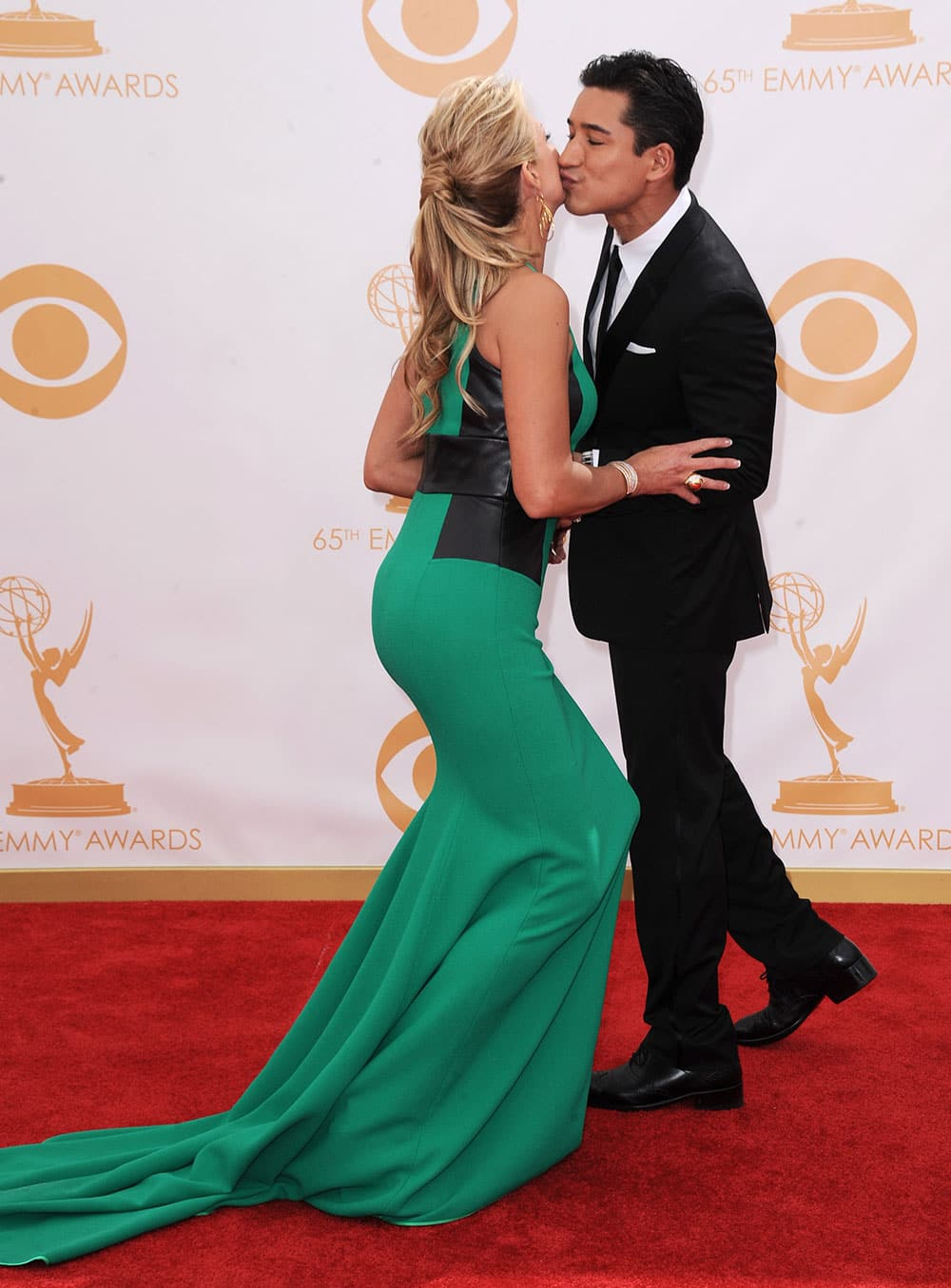 Mario Lopez and Nancy O'Dell arrive at the 65th Primetime Emmy Awards at Nokia Theatre.