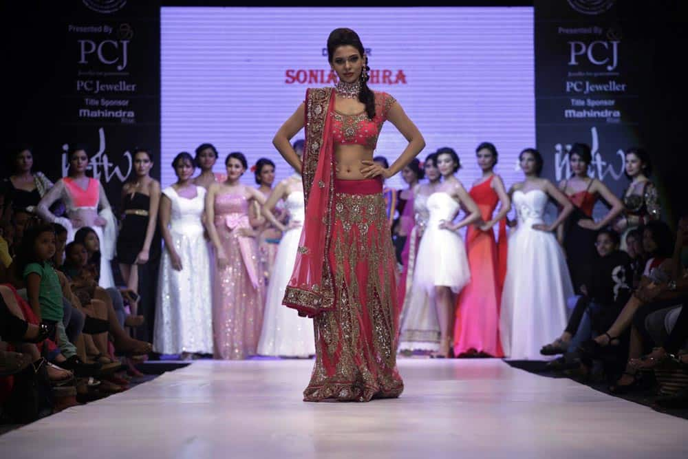 Models display creations by Sonia Mehra during the India Jewelry and Fashion Week in Ahmedabad.