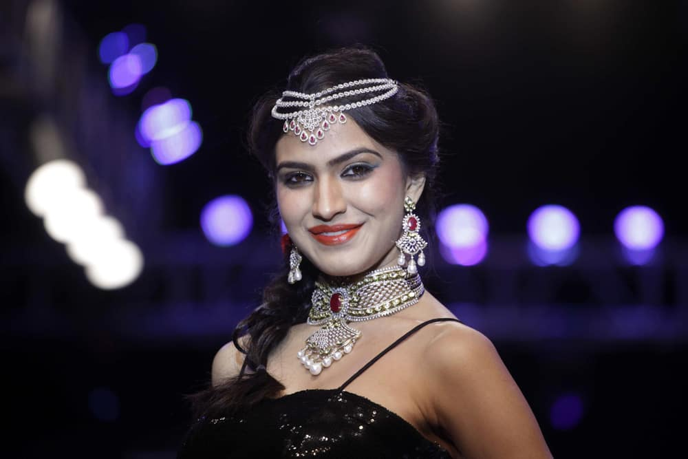 A model displays a creation by Kiah during the India Jewelry and Fashion Week in Ahmedabad.