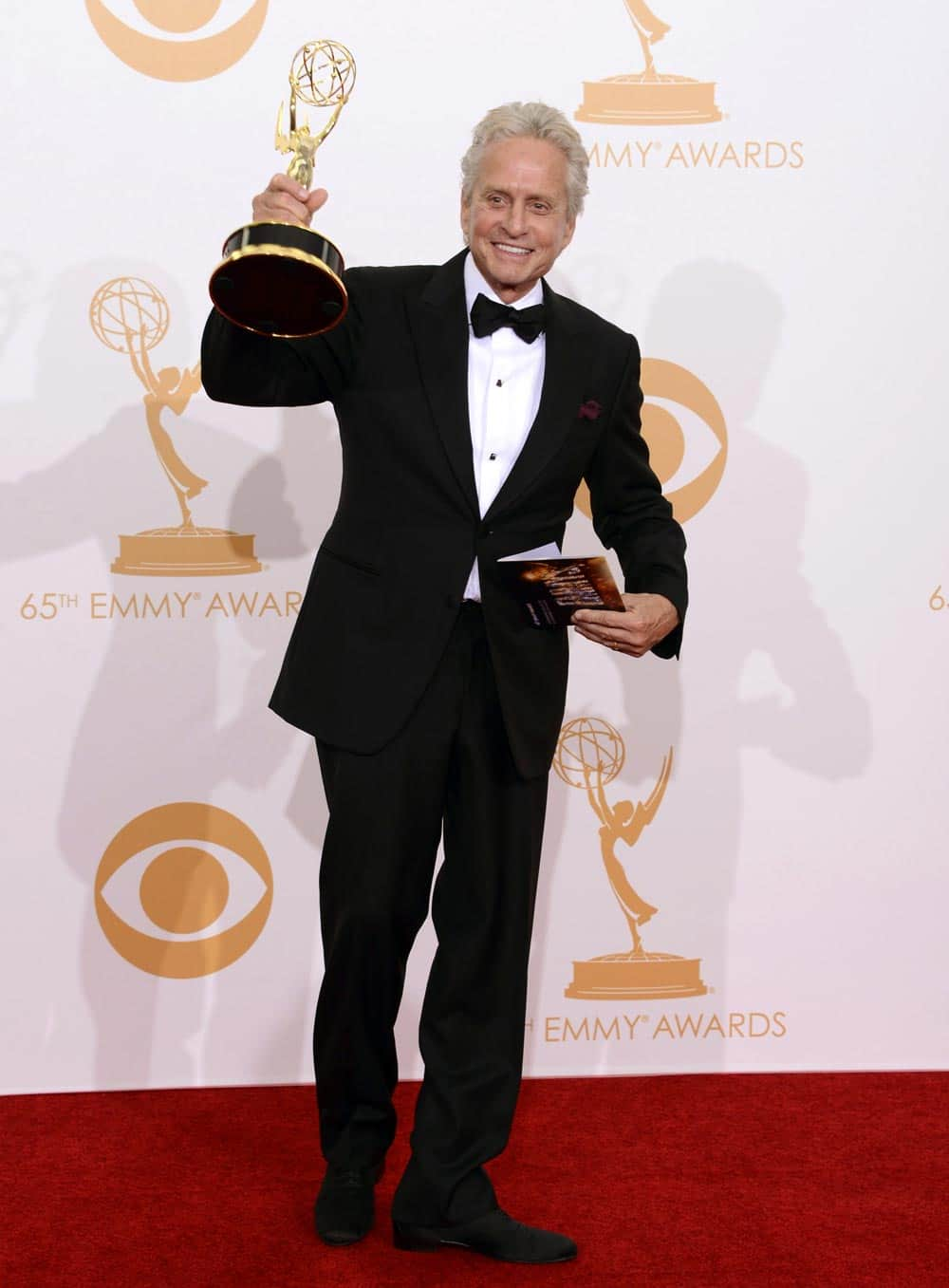Michael Douglas, winner of the Best Lead Actor in a Miniseries or Movie Award for 'Behind The Candelabra' poses backstage at the 65th Primetime Emmy Awards at Nokia Theatre.