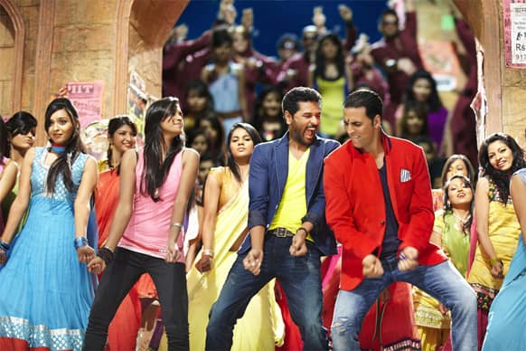 Akshay Kumar matching dance steps with Prabhudeva in this still from 'BOSS'.