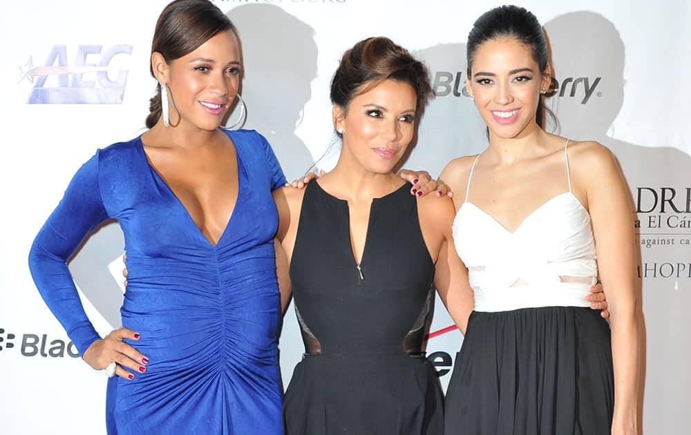Dania Ramirez, from left, Eva Longoria, and Edy Ganem arrives at the 2013 El Sueno De Esperanza Gala at the Club Nokia L.A. Live in Los Angeles.