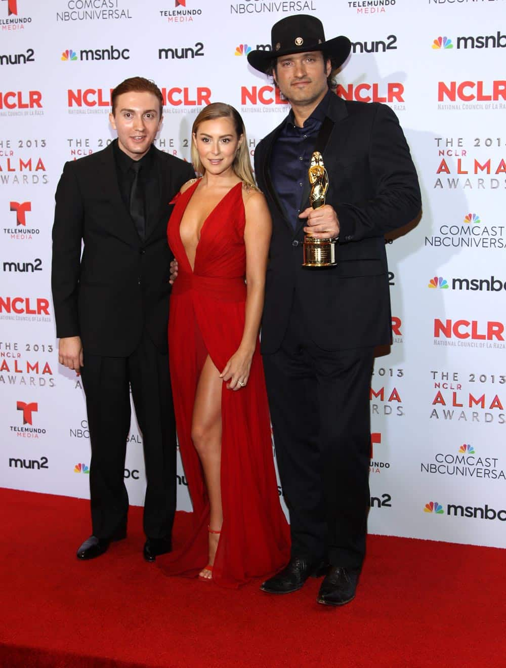 Daryl Sabara, Alexa Vega and winner of the Anthony Quinn award for achievement in film Robert Rodriguez pose backstage at the NCLR ALMA Awards at the Pasadena Civic Auditorium, in Pasadena.
