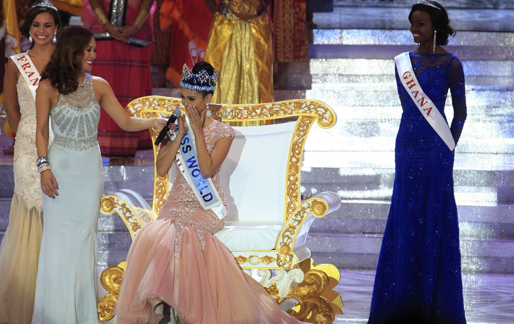 Newly crowned Miss World, Megan Young of the Philippines, center, reacts after winning the Miss World contest, in Nusa Dua, Bali, Indonesia.
