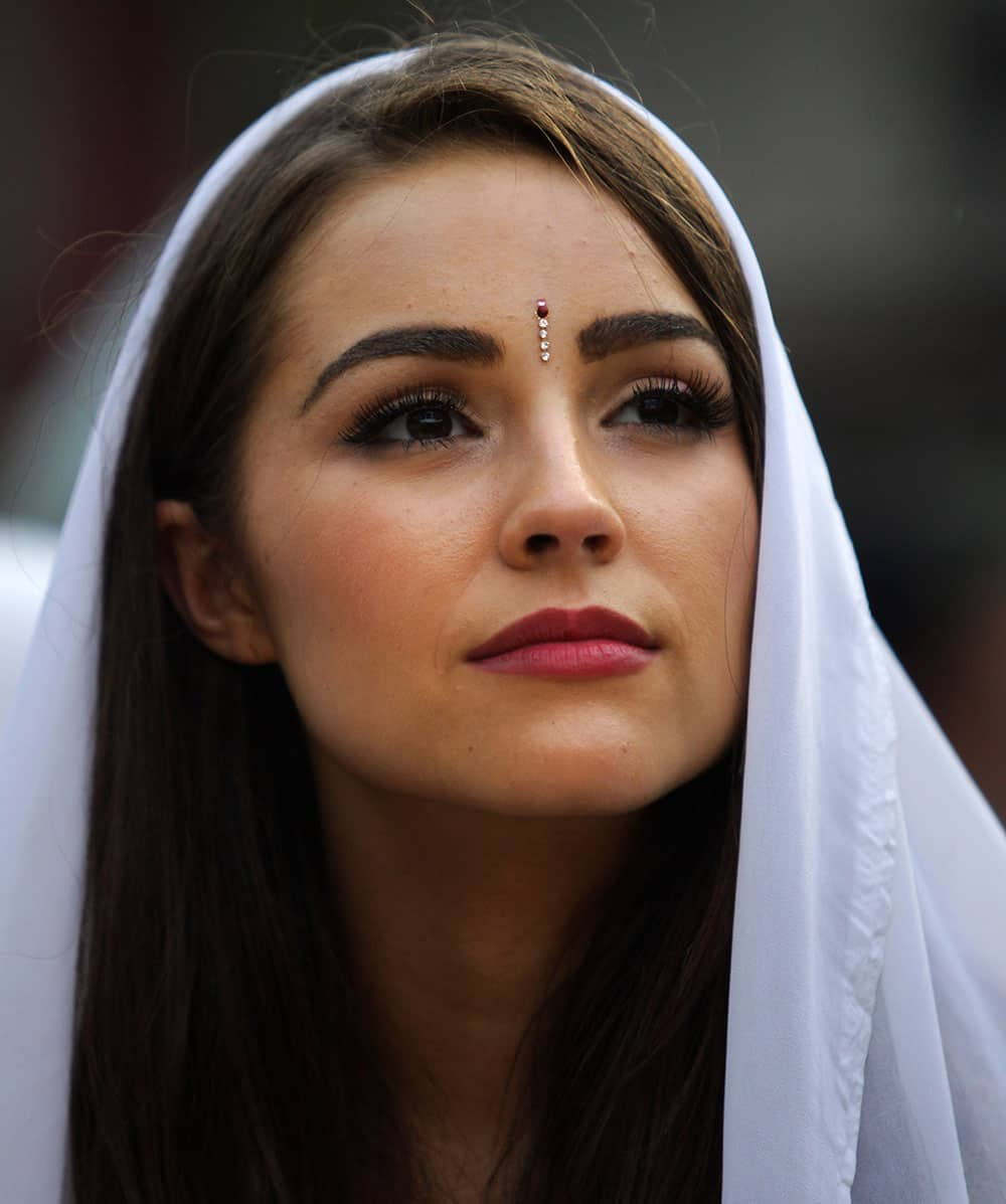 Miss Universe, Olivia Culpo of the USA, watches a performance by inmates during a visit to the Tihar Jail in New Delhi.