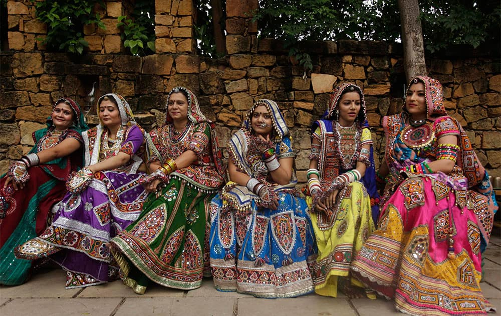 Women dressed in traditional finery watch others practice the Garba dance ahead of the Navratri festival in Ahmadabad.