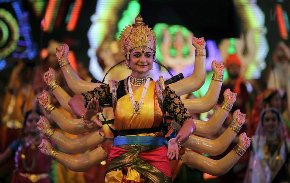 A artist performs during the grand rehearsal for Navratri celebrations in Ahmadabad.