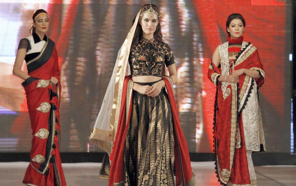 Models present creation of Bangladeshi designer Shahrukh Amin during Islamabad Fashion Week.