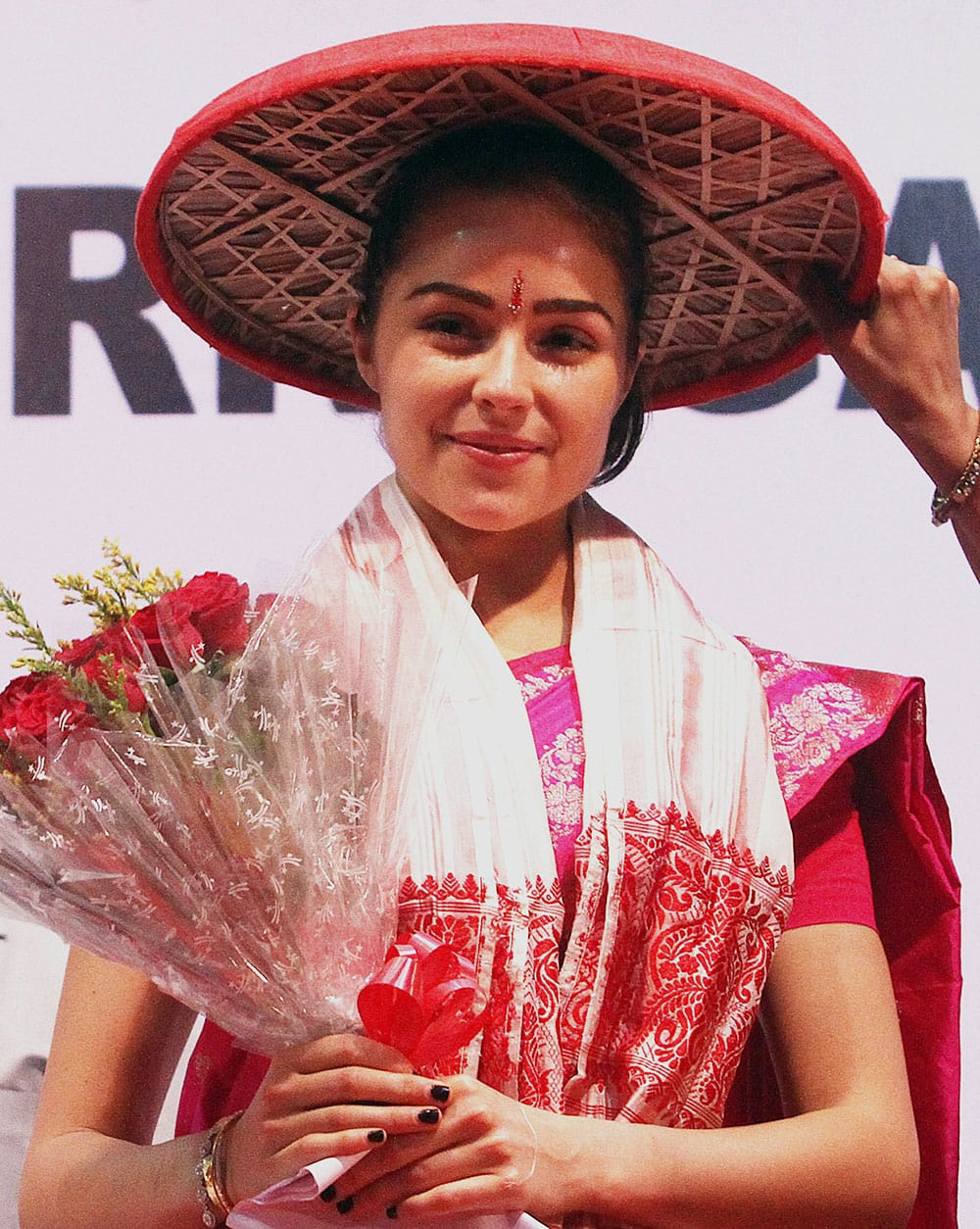 Miss Universe Olivia Culpo wears a traditional Assamese hat called Japi during a campaign