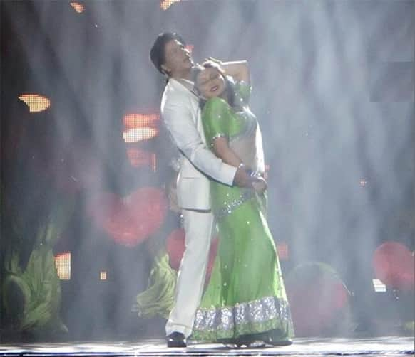 Shah Rukh and Rani in a romantic embrace while performing on stage during the Temptation event in Australia.