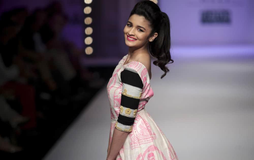 Alia Bhatt displays a creation by Masaba during the Wills Lifestyle India Fashion Week in New Delhi.