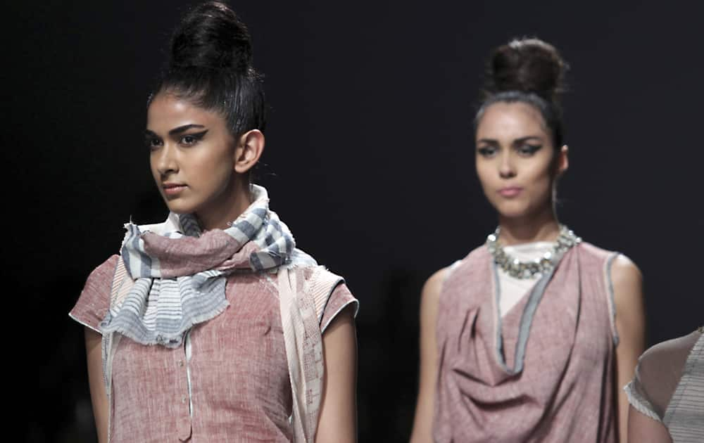 Models display creations by Urvashi Kaur during the Wills lifestyle Fashion Week in New Delhi.