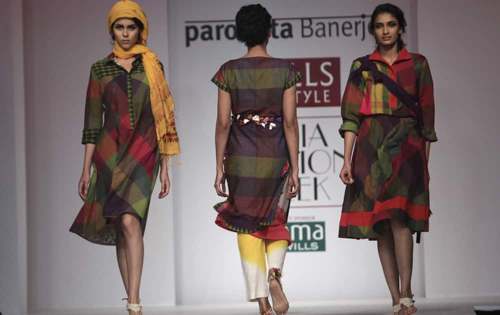 Models display creations by Paromita Banerjee during the Wills lifestyle Fashion Week in New Delhi.
