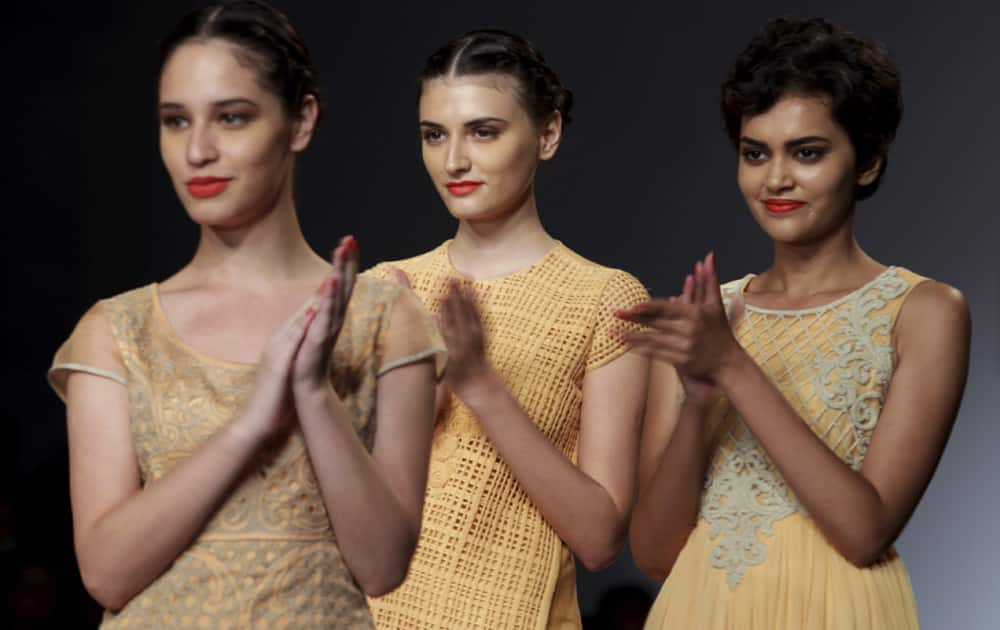 Models display creations by Manish Gupta during the Wills lifestyle Fashion Week in New Delhi.