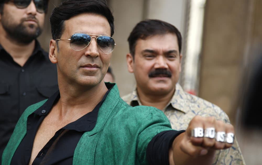 Akshay Kumar shows his rings during a promotional event of his upcoming movie
