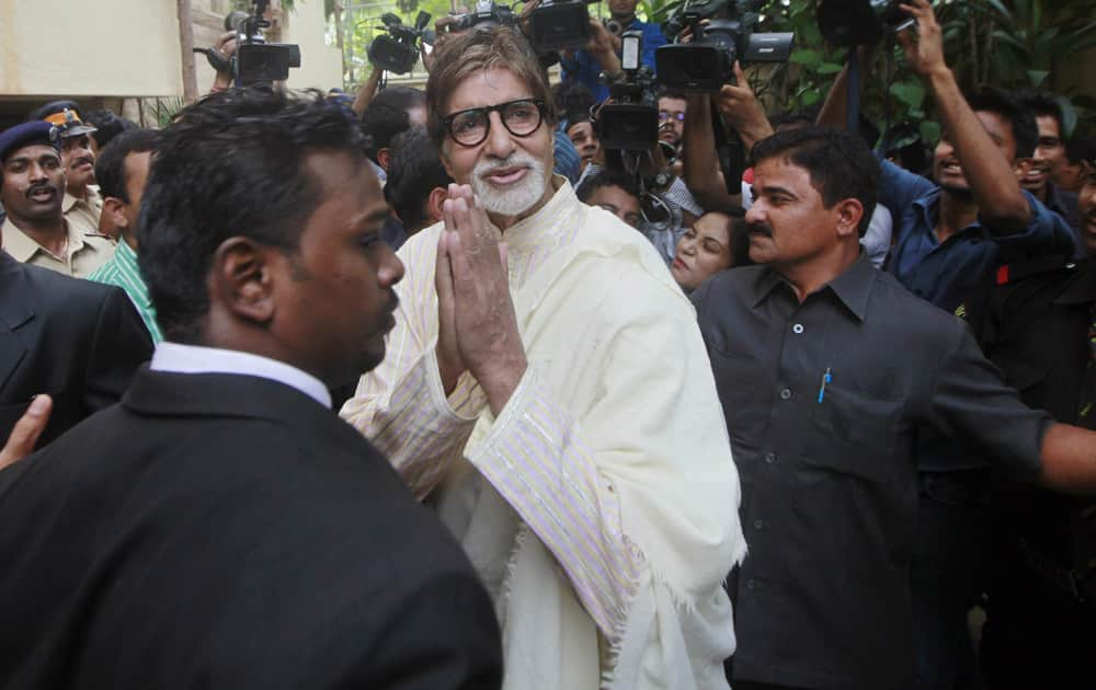 Amitabh Bachchan greets his fans outside his residence on his 71st birthday in Mumbai.