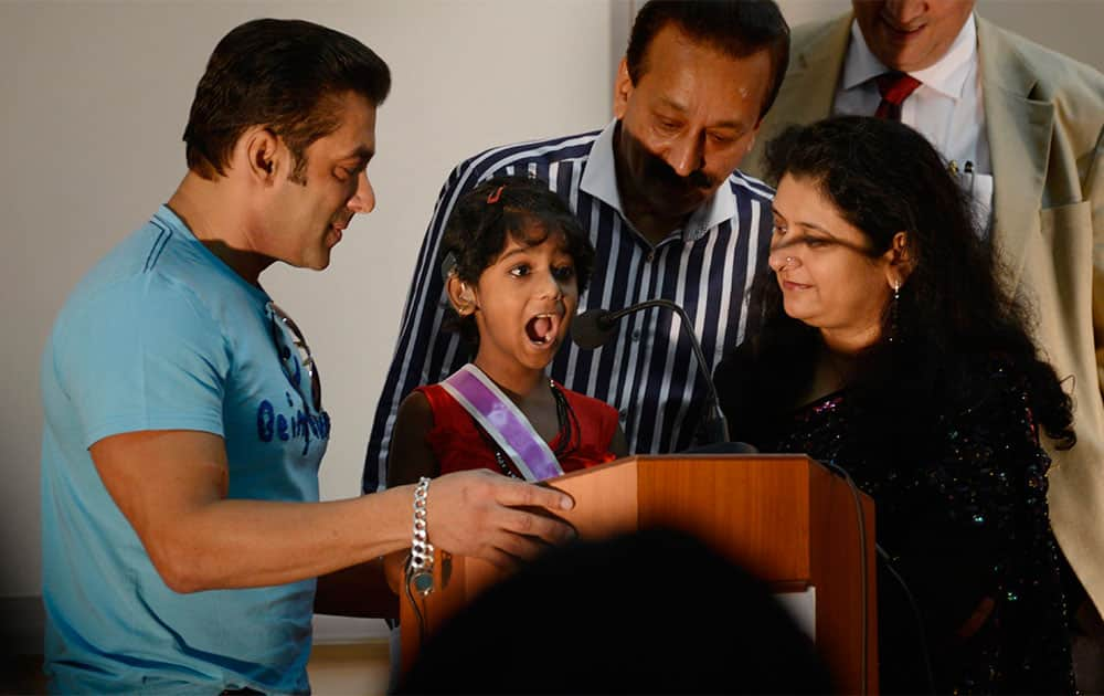 Bollywood actor Salman Khan (L) poses with the children during the second anniversary celebration of Cochlear implants facility for underprivileged children at Holy family hospital in Mumbai. Pic Courtesy: DNA