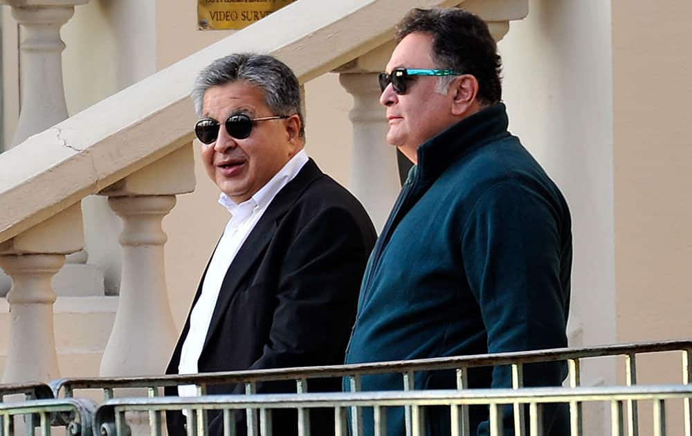 Bollywood actor Rishi Kapoor leaves the Carlton hotel along with an unidentified friend prior to the wedding parade of Kunal Grover, son of London-based industrialists Kimi and Pamela Grover, in Cannes, southern France.