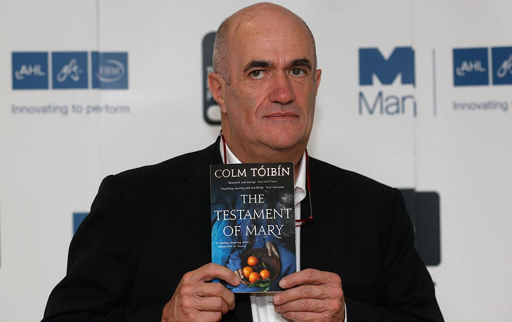 Irish author Colm Toibin poses with his book 'The Testament of Mary' during a photocall for the shortlisted authors of the 2013 Man Booker Prize for Fiction at the Queen Elizabeth Hall in London.
