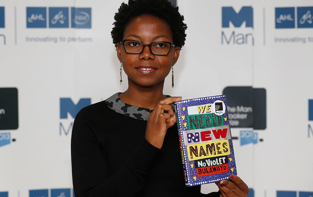 Zimbabwean author NoViolet Bulawayo poses with her book 'We Need New Names' during a photocall for the shortlisted authors of the 2013 Man Booker Prize for Fiction at the Queen Elizabeth Hall in London.