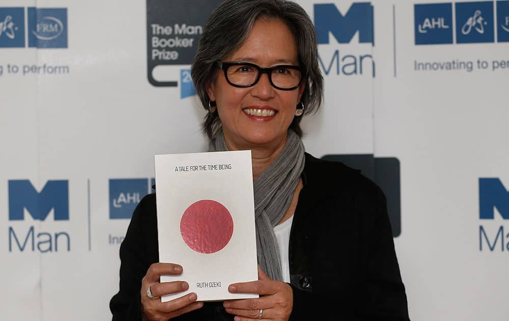 United States author Ruth Ozeki poses with her book 'A Tale for the Time Being' during a photocall for the shortlisted authors of the 2013 Man Booker Prize for Fiction at the Queen Elizabeth Hall in London.