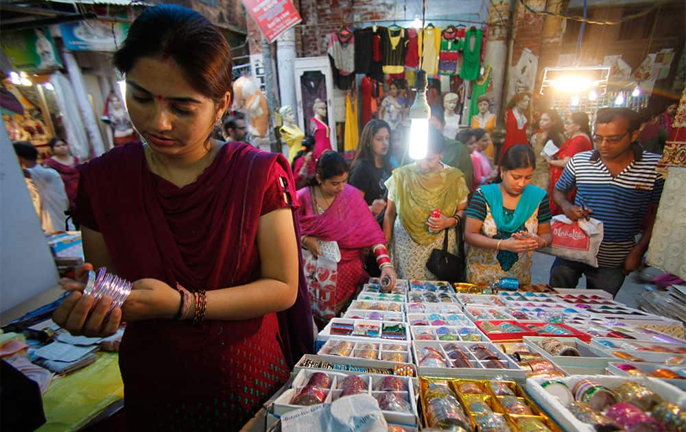 Women shop for bangles on the eve of Karwa Chauth festival in Jammu.