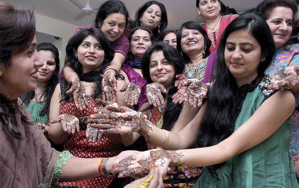 Women with 'mehandi' on their hands ahead of 'Karva Chauth' in Indore.